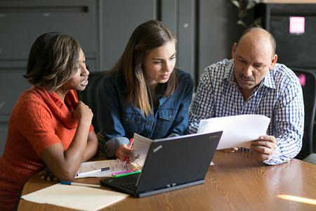Three educators talking
